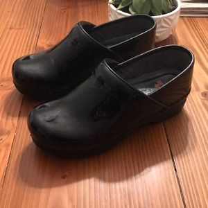 Dansko XP patent leather black clogs